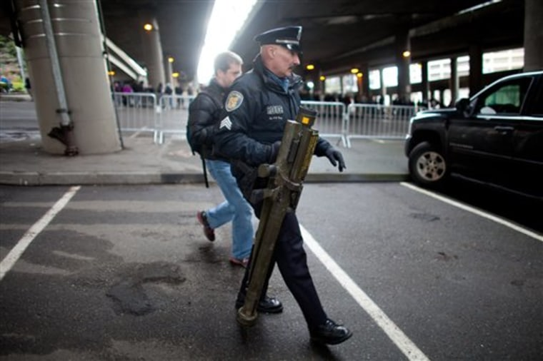 Seattle Police Department Sgt. Paul Gracy holds an inert surface to air missile launcher brought to a gun buy back program run by the Seattle Police Department on Saturday, Jan. 26, 2013.