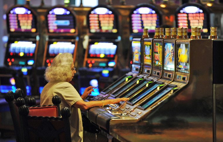 A tourist plays in a casino at a resort in Nassau, Bahamas. Locals are barred from betting in casinos at the islands' tourist resorts.