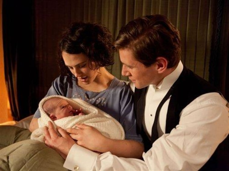 Lady Sybil and Tom hold their newborn daughter, for the family's one short moment of happiness.