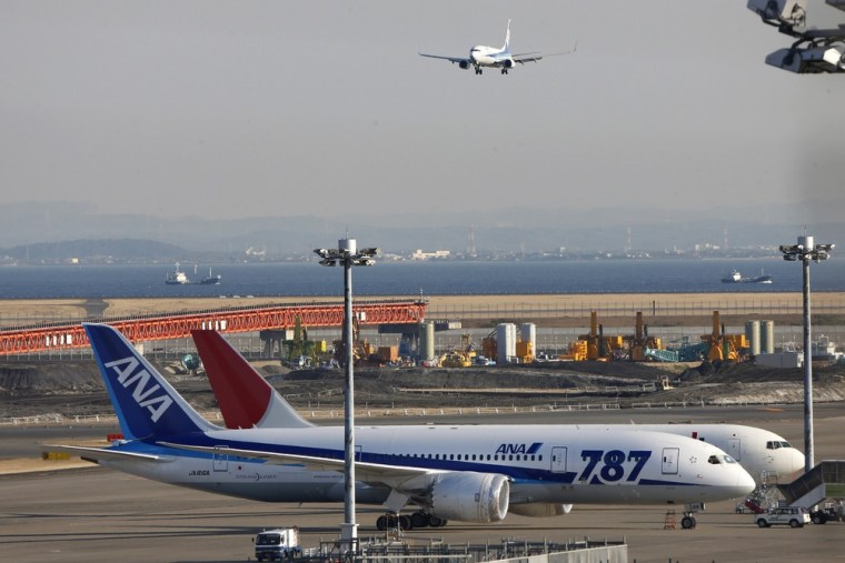 An All Nippon Airways' Boeing 787 Dreamliner sits on the tarmac at Haneda Airport in Tokyo, Wednesday, Jan. 30, 2013.