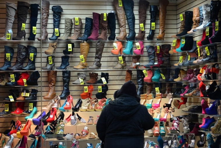 A woman look at shoes on a display sale in New York, January 28, 2013.