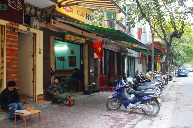 In this photo taken Jan. 5, 2013, customers drink coffee on Trieu Viet Vuong Street in Hanoi, Vietnam. Dunkin Donuts said Wednesday it plans to expan...