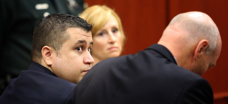 George Zimmerman, left, sits with defense counsel at the Seminole County courthouse Tuesday in Sanford, Fla., on Dec. 11, 2012.