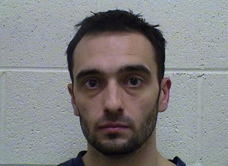 Dennis Robinson, 28, is accused of smoking crack cocaine inside his SUV with his 2-year-old twins in the back seat.
