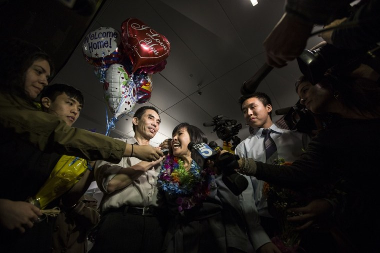 Human rights activist Nguyen Quoc Quan (center left), seen with his wife Huong Mai Ngo and their sons Khoa, 20, and Tri, 19, speaks during a press conference after his arrival at the Los Angeles International Airport from Vietnam on Jan. 30, 2013.