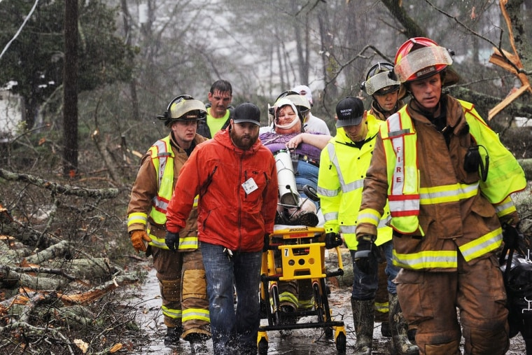 Emergency crews rescue Brenda Mulkey, injured at her home when a suspected tornado touched down in Adairsville, Ga. Wednesday.