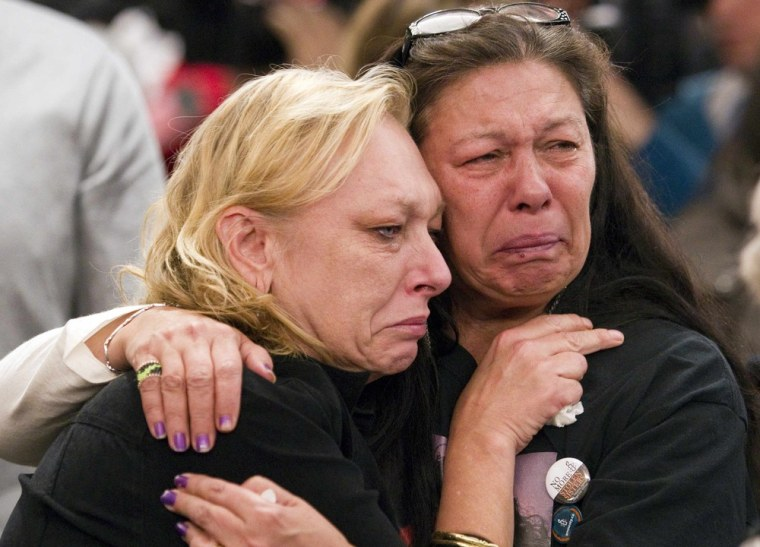 Women whose daughters are part of a missing women's inquiry in Canada cry during discussion of a report, titled 'Forsaken,' that examines the mishandling of the Robert Pickton serial killer case.