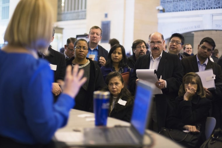 Job seekers listen to a social media expert during a job fair in New York, January 10, 2013.