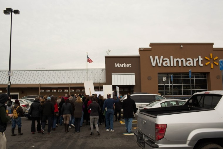 Protestors stand outside the Danbury Walmart January 15, 2013 in Danbury, Connecticut. Wal-Mart says it has begun to limit sales of ammunition to thr...