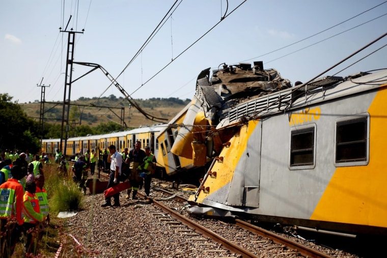 Paramedics tend to some of the people injured when two trains collided near Pretoria, South Africa, on Thursday.