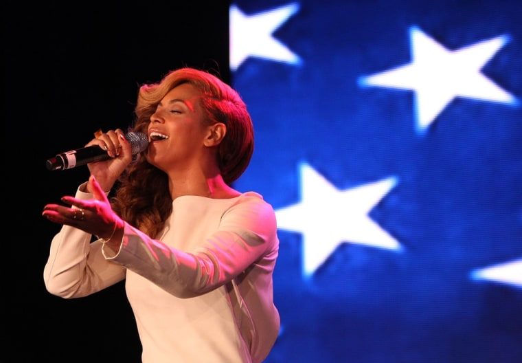 Beyonce sings the national anthem before she addresses the media during the Pepsi Super Bowl XLVII Halftime Show press conference in New Orleans on Thursday.