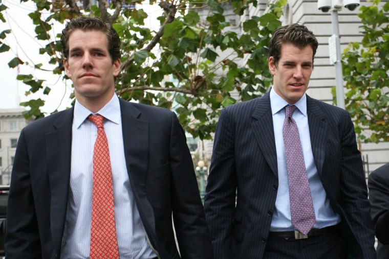 Picture taken on January 11, 2011 shows Cameron (L) and Tyler (R) Winklevoss, founders of social networking website ConnectU, leaving the US Court of ...