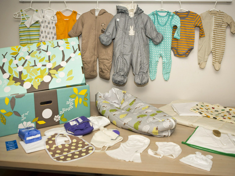The contents of the maternity gift box Finland's social security service sent to Prince William and Duchess Kate, who are expecting their first baby in mid-July. The brightly colored cardboard box doubles as a cot, complete with mattress and sheets.