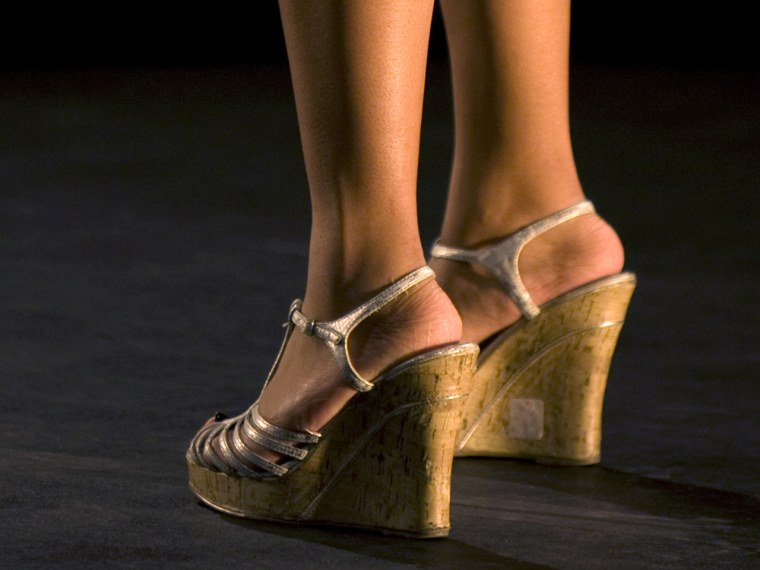 legs of a female model on catwalk during a fashion show