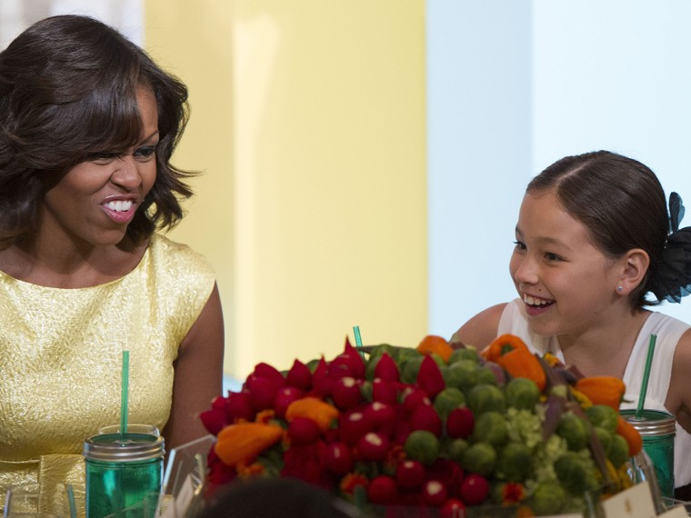 "US First Lady Michelle Obama (L) talks with Washignton State Winner Amber Kelley during the Children's State Dinner for winners of the ""Healthy Luncht..."