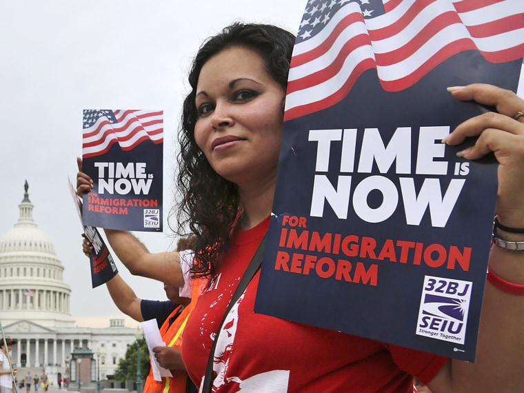 A group of immigrants and activists for immigration reform, led by Service Employees International Union (SEIU) and CASA, chant as they march to urge congress to act on immigration reform, on Capitol Hill, June 26, 2013.