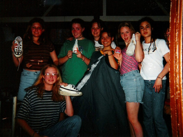 Sarah Culp, in green shirt, along with her camp mates, after a fire caught in their cabin.