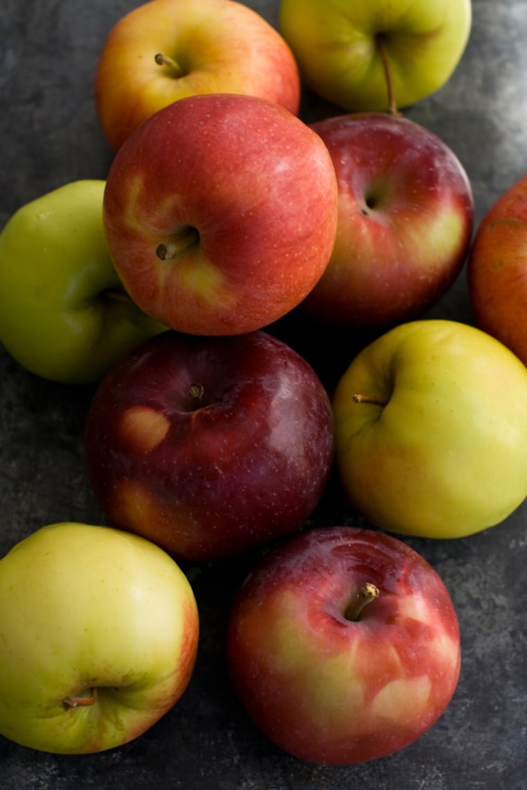 This Oct. 11, 2011 photo shows an assortment of apples in Concord, N.H. The symbolic value of apples is exceeded only by their versatility. Raw, they'...