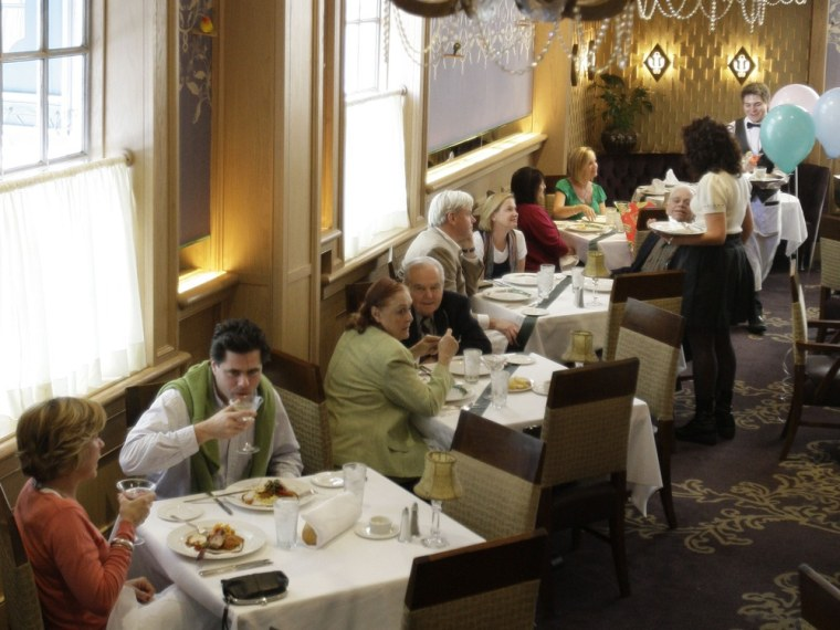 Diners enjoy lunch in the main dining room at Commander's Palace in the Garden District of New Orleans in 2009. The restaurant industry has realized t...