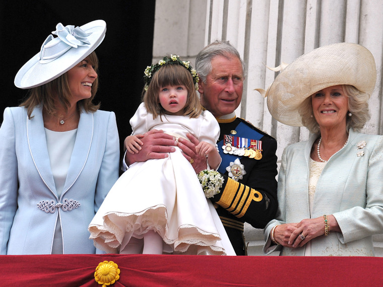 LONDON, ENGLAND - APRIL 29:  (L-R) Michael Middleton, Carole Middleton, Prince Charles, Prince of Wales holding bridesmaid Eliza Lopes and the Camilla...
