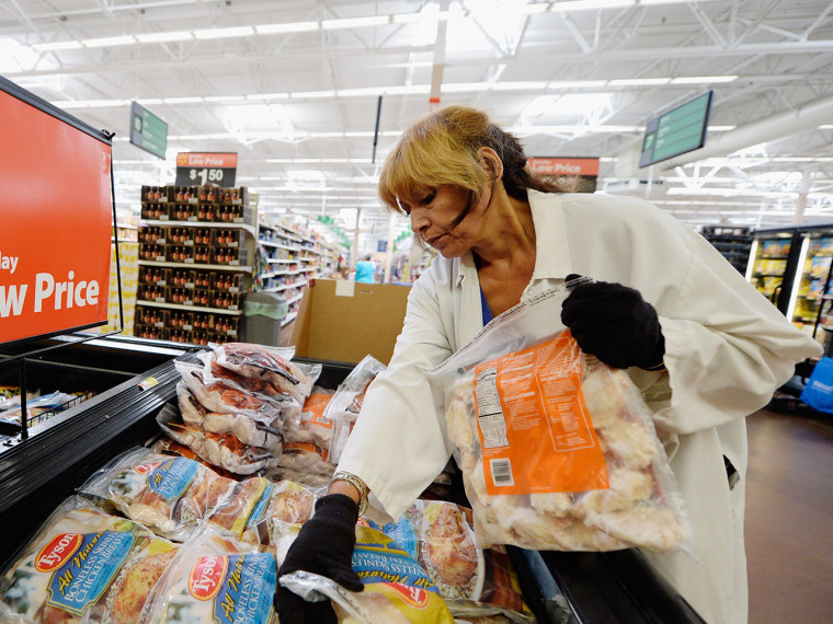 PICO RIVERA, CA - MAY 30: Employee Lucy Rodriguez stocks the frozen meat section of a Walmart Supercenter store on May 30, 2013 in Pico Rivera, Calif...
