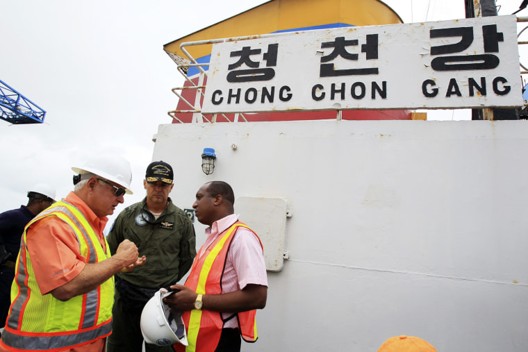 Panamanian President Ricardo Martinelli (left) speaks with officials during a tour of the ship on Tuesday.