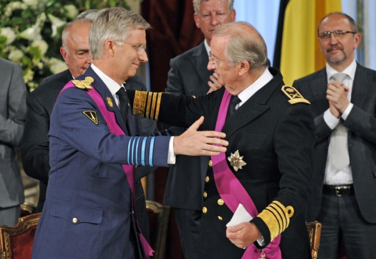 King Albert II of Belgium (R) and Prince Philippe of Belgium (L) during the Abdication Ceremony of King Albert II Of Belgium in favor of Prince Philippe at the Royal Palace on July 21, 2013 in Brussels.