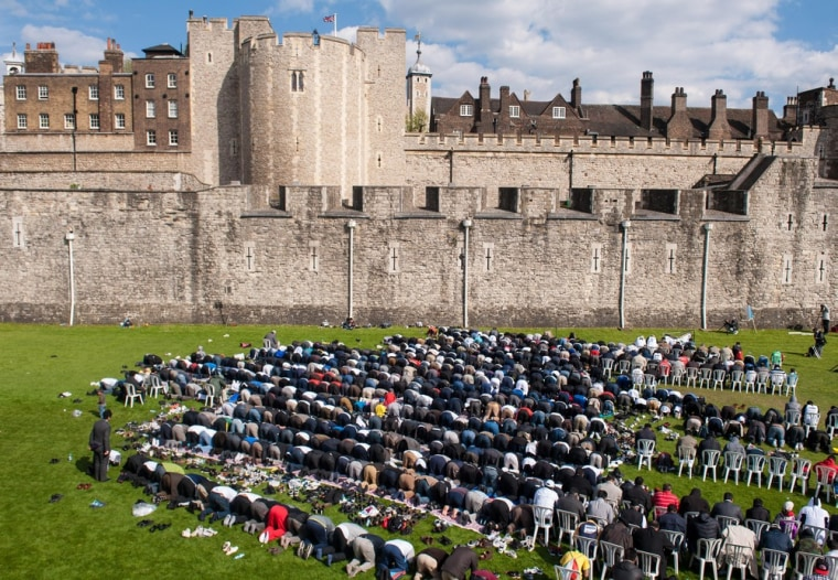 British Muslims take part in afternoon prayers at the Tower of London.