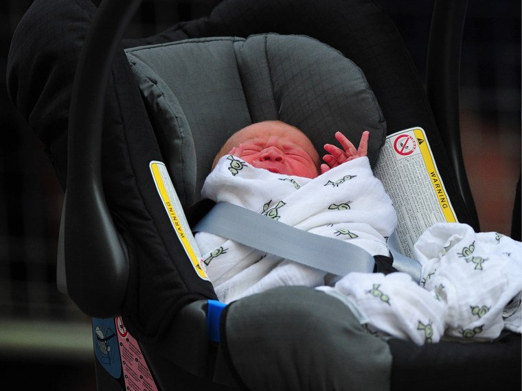 Image: Prince William and Duchess Kate's newborn baby boy is seen in a car seat outside the Lindo Wing of St Mary's Hospital in London.