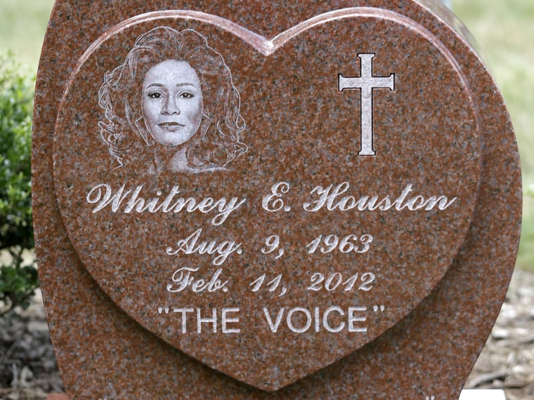 This Tuesday July 23, 2013 photo shows the new headstone at the grave of singer Whitney Houston, at Fairview Cemetery in Westfield, N.J., about 20 mil...