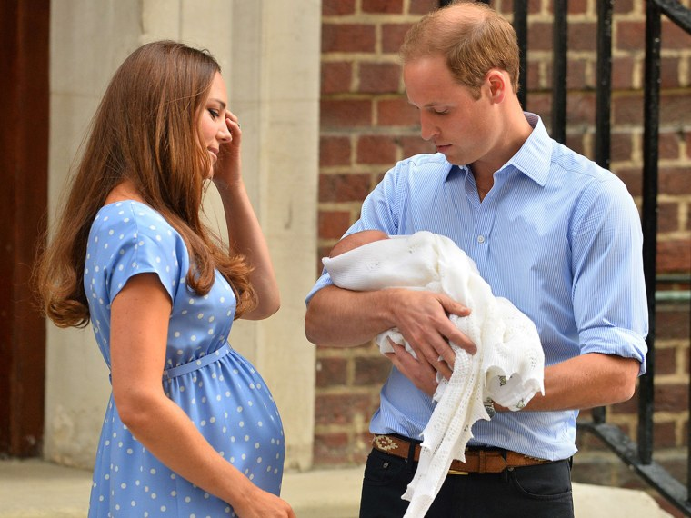 TOPSHOTS  Prince William and Catherine, Duchess of Cambridge show their new-born baby boy to the world's media outside the Lindo Wing of St Mary's Hos...