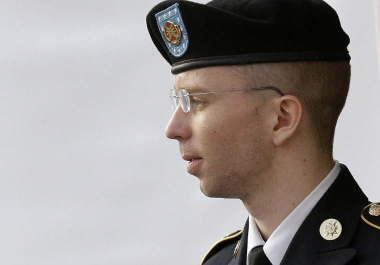Army Pfc. Bradley Manning is escorted to a security vehicle outside a courthouse in Fort Meade, Md., Thursday, July 18, 2013, after a court martial hearing.