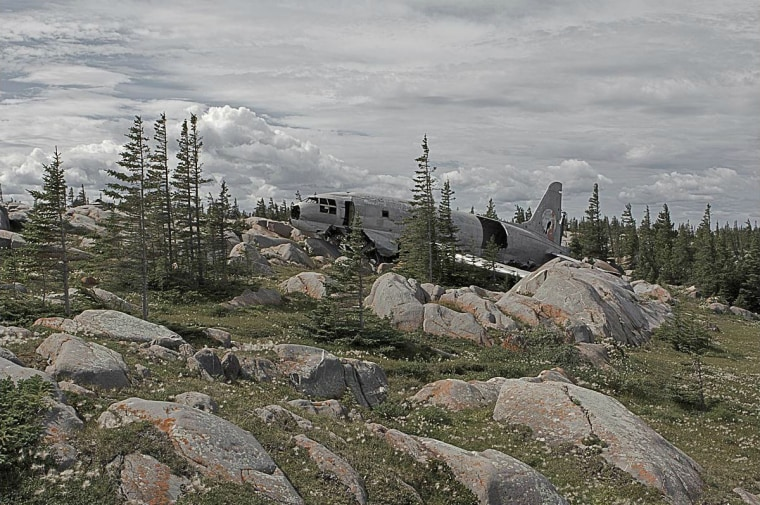 Curtiss C-46 Commando near Churchill, Manitoba, Canada. Reportedly, this aircraft was overloaded when it was forced to land in 1979 a half-mile short of a nearby airport. All the passengers survived.