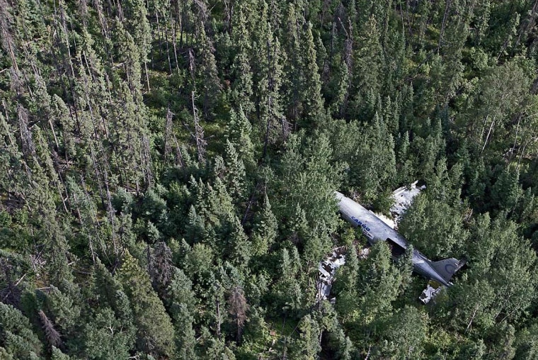 Curtiss C-46 Commando near Thompson, Manitoba, Canada. This cargo lost height due to engine problems and was force-landed in trees in 1977 while trying to return to the airport. The two crew members survived.