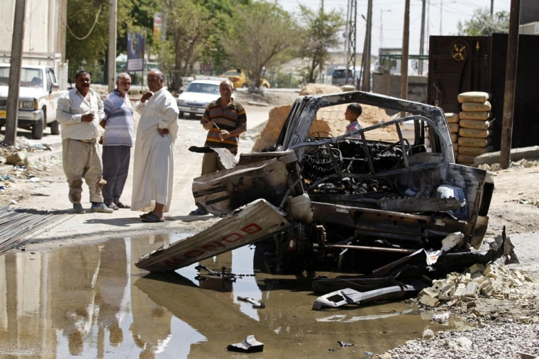 Civilians inspect the aftermath of a car bomb attack in Baghdad, Iraq, on July 24. A bomb exploded near a Sunni mosque in Baghdad's southern Dora neighborhood on Tuesday, killing several people and wounding many more, police said.