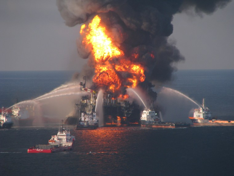Fire boat response crews battle the blazing remnants of the offshore oil rig Deepwater Horizon, off Louisiana, in this handout photograph taken on April 21, 2010.