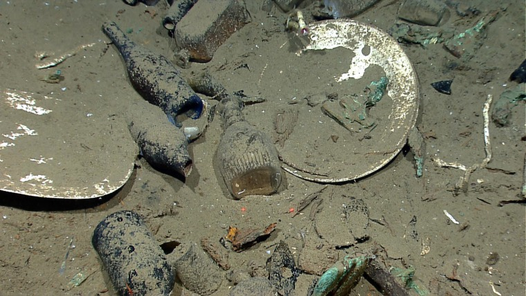 Artifiacts including ceramic plates, platters, bowls plus glass liquor, wine, medicine, and food storage bottles of many shapes and colors found inside a wrecked ship's hull, in the Gulf of Mexico about 170 from Galveston, Texas.