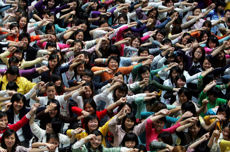 Chinese girls take part in a promotional event for talent show Super Girl at a shopping mall in Chengdu, in this 2006 file photo.