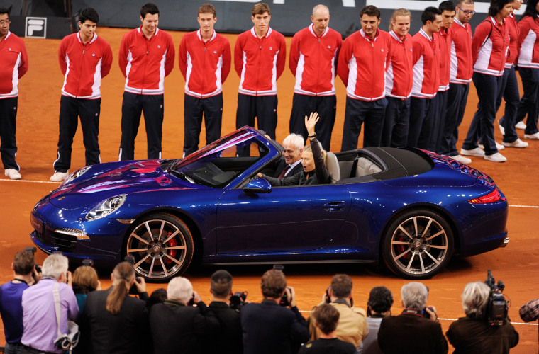 Maria Sharapova from Russia, right, and CEO of Porsche AG, Matthias Mueller drive in a Porsche 911 Carrera 4S Cabriolet during the victory ceremony af...