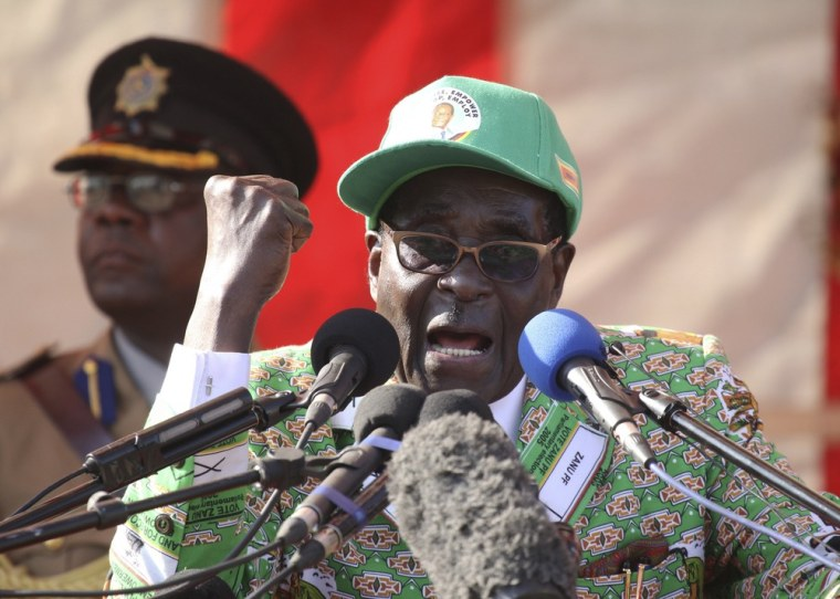 Zimbabwean President Robert Mugabe delivers a speech at the launch of his party election campaign in Harare, Friday, July, 5, 2013.