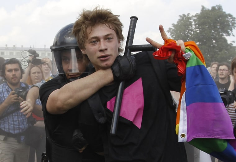 Police detain a gay rights activist during a Gay Pride event in St. Petersburg on June 29, 2013.