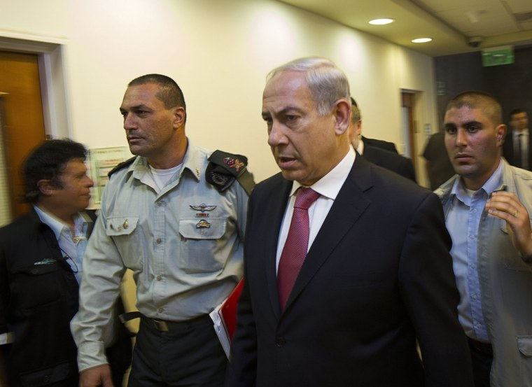 Israel's Prime Minister Benjamin Netanyahu arrives for the weekly cabinet meeting in Jerusalem on July 28, 2013. During the meeting, Netanyahu's cabinet approved a divisive Israeli decision to release 104 Arab prisoners in order to restart peace talks with the Palestinians.