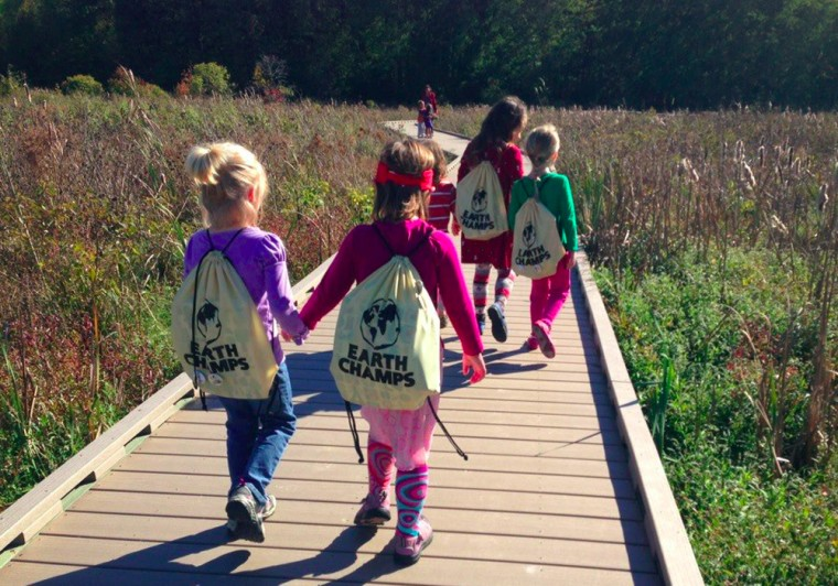 Earth Champs learn about nature during a hike in Huntley Meadows Park in Alexandria, Va.