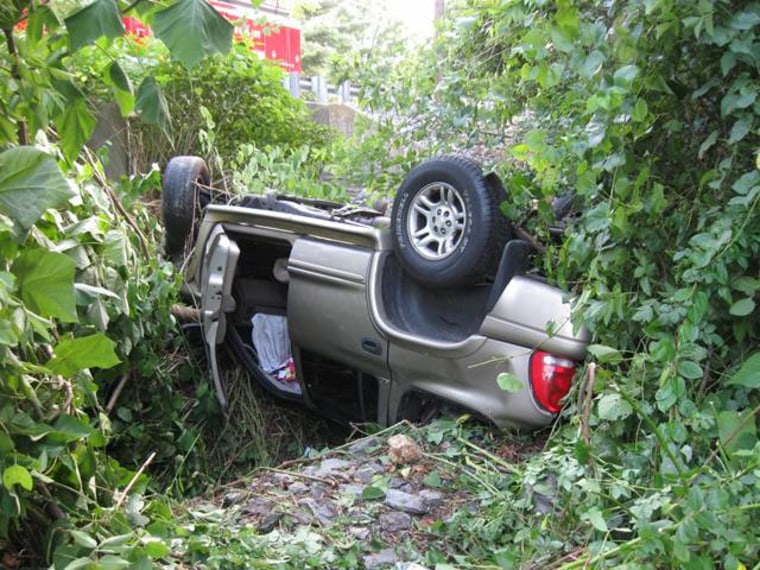 Police believe this SUV crossed the center line, struck a pole and went airborne about 20 feet before landing on its front and flipping over onto its roof late Saturday in West Hempfield Township, Pa.