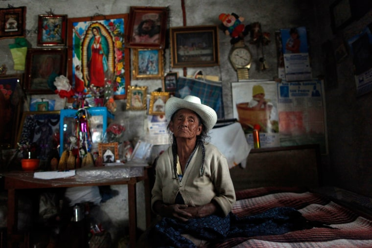 Refugio, 82, poses for a photograph inside her house in Zitlaltepec, Mexico, July 26.