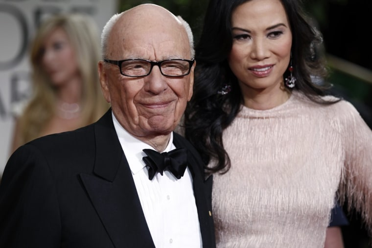 In this Sunday, Jan. 15, 2012, file photo, Rupert Murdoch and Wendi Deng arrive at the 69th Annual Golden Globe Awards in Los Angeles.