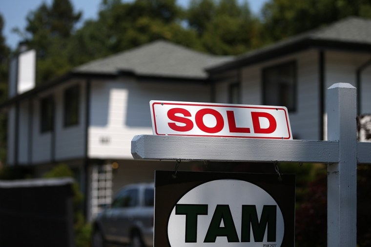 A sold sign is posted in front of a home for sale on July 2, 2013 in San Anselmo, California.