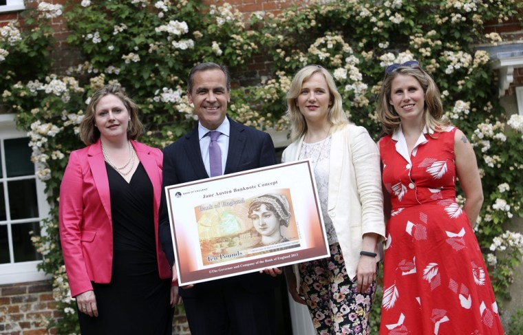 (L-R) Mary Macleod, a Conservative member of parliament, Governor of the Bank of England, Mark Carney, Stella Creasy, a Labour and Co-operative member of parliament, and Caroline Criado-Perez, co-founder of the Women's Room, pose following the presentation at the Jane Austen House Museum on July 24, 2013 in Chawton, near Alton, England.