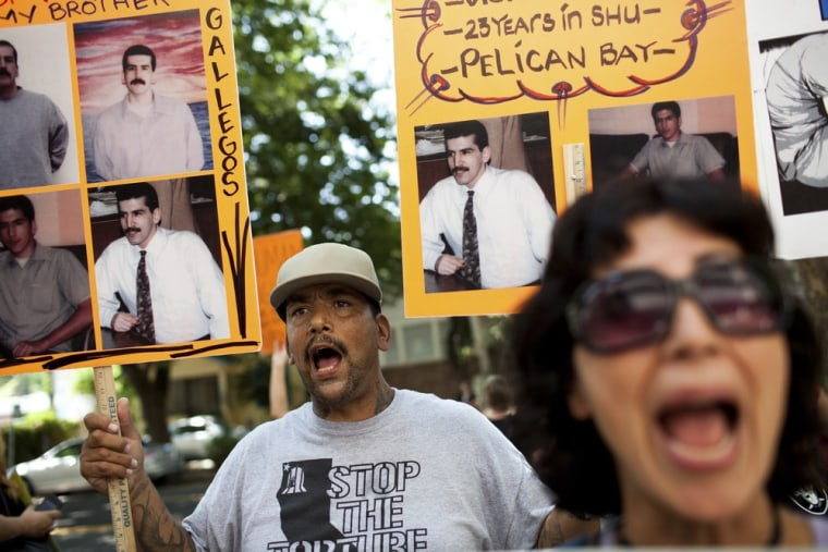 Mitchell Giovannini and Diya Cruz protest against indefinite solitary confinement in California prisons, outside the California Department of Corrections and Rehabilitation office in Sacramento, California July 30, 2013.
