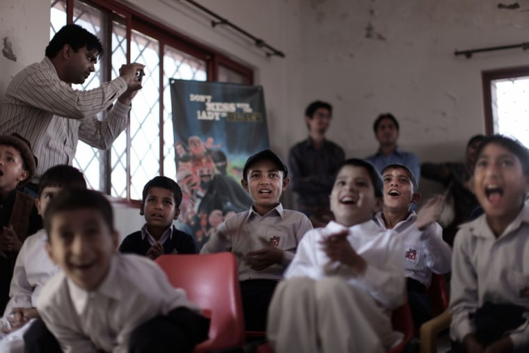 Pakistani orphans react while watching an early screening of the first episode of Burka Avenger animated series, at an orphanage on the outskirts of Islamabad, Pakistan on March 25, 2013.